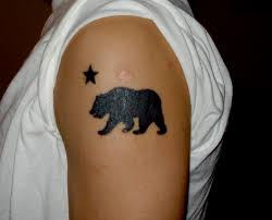 Silhouette Bear With Star Tattoo On Left Shoulder