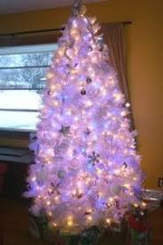 white tree multicolor lights merry and happy