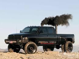 100 Badass Mud Trucks Dodge Cummins Dually Rollin Coal In A Badass Lifted Nd Gen Ram