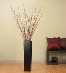 Red Sticks In A Vase
