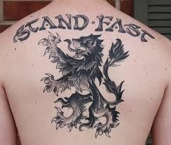 Awesome Grey Scottish Tattoo On Upper Back