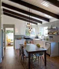 love the high ceilings and pendant lights and the casual table in