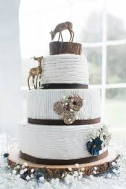 Rustic Wedding Cake With Deer And Tree Stump Decoration