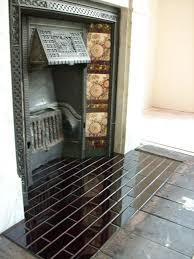 woodburner inset and hearth tiled with handmade terracotta tiles