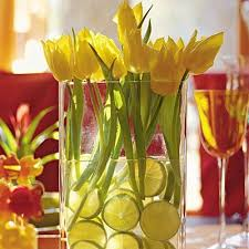 Read More Ideas To Jump Start Your Spring Table DecorTo Create A Dramatic And Colorful Centerpiece Place Yellow Tulips In Simple Vase