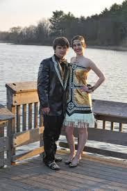 couple poses for a prom photo but wait til you see their