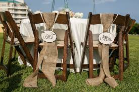 Rustic Burlap Wedding Decorations With Small Flowers On Round Table Also Wooden Folding Chairs