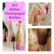 DIY Glittered Champagne Bottles Glitter CenterpiecesTable CenterpiecesCenterpiece IdeasAdult Party