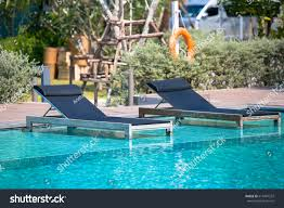 Swimming Pool Lounge Chairs Umbrellas On Stock Photo (Edit Now ... Commercial Pool Chaise Lounge Chairs Amazoncom Great Deal Fniture 295530 Eliana Outdoor Brown Wicker 70 Most Popular For 2019 Camaxidcom Swimming Pool Deck Chair Blue Wheeled Chaise Longue Vector Image With Shallow Lounge Chairs Submersed In Water Orbital Zero Gravity Folding Rocking Patio Chair Pillow Diy And Howto Video Shanty 2 Chic Ottawa Wondrous Design In Johns Flat For Your Poolside Stock Image Of Color Vertical 15200845 A Five Star Hotel Keralaindia