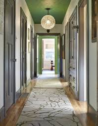 lighting narrow hallway furniture with gray trim and green