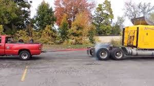 Chevy Pickup Beats Semi Truck In Tug Of War