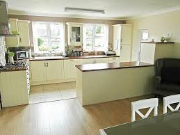 Photo Of Cream Olive White Kitchen With Floor Tiles Flooring Tiled Splashback Wooden And Stainless Steel Extractor Glass F