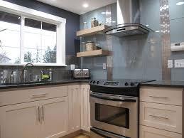 modern kitchen with glass tile backsplash by cornerstone builders