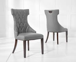 Freya Grey Faux Leather Dining Chairs Cream Faux Leather Ding Chair With Curved Leg Crossley Single Adela Maple And Lpd Padstow Chairs Pair Brown Or Red Faux Leather Ding Chairs Antique Vintage Button Stud Detail Pack Of 2 Table Seat Set Bolero Tan Mark Harris California Simpli Home Cosmopolitan 9piece 8
