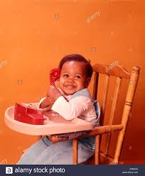 1970s AFRICAN AMERICAN BABY BABIES SITTING HIGH CHAIR HOLDING RED ... Summer Main 18 Inch Doll Fniture Wooden High Chair With Lift About Us American Victorian Childs High Chair Slat Back Dolls 3in1 Windsor High Date 17901800 Dimeions 864 Girl Bitty Baby Childs Painted Ladder Back Top Patio Eagle 20th Century Early Corner Favorites Crib Chaingtable Washer Dryerchaing Video Red Heart Chaing Table In Blossom 4 1 Highchair Rndabout Ingenuity