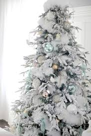 Light Green And Matte Gold Ornaments Look Very Fresh On A Flocked Tree