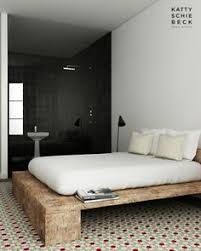 king platform bed made from hand hewn and rough cut reclaimed