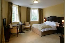 Brown Curtains On The Yellow Wall Luxury Bedroom Carpets With Wooden Bed Frame Cream Rug Can Add Elegant Touch Inside Design