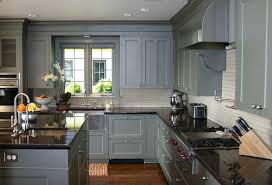 grey cabinets with black counters wood floors countertops