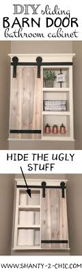 Build A Custom Sliding Barn Door Storage Cabinet Perfect For Toilet Paper And Other