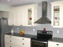 grey subway tile backsplash and white cabinet also stainless steel