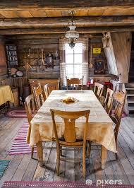 fototapete esszimmer tisch und stühle in einem blockhaus