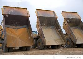 100 Large Dump Trucks Three Large Dump Trucks As Seen From Behind