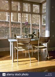 Modern Kitchen Dining Area Wood Floor Metal Table Woven ...