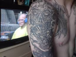 Grey Ink Gothic Tattoo On Man Right Shoulder