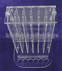 China Countertop Beauty Product Display Stand Polishing Acrylic Lip Balm Rack Supplier