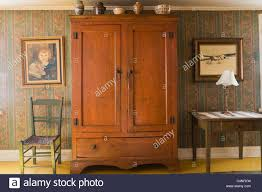 Antique Armoire In Bedroom Of 19th Century Home, Quebec, Canada ... 72 Best Antique Armoire Images On Pinterest Armoire 33 Bureau And Cupboards Painted Antique Beside Window With Heavy Cream Curtain In Closet French Wardrobe Storage Fniture Abolishrmcom Vintage Fniture With Mirror Lawrahetcom An Overview Of Elites Home Decor Hutch Ladybirds Mandeville La At Geebo Wardrobe Closet Massachusetts Ideas All Home