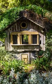 Rustic Large Wood Bird House Situated In Garden