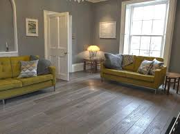 Grey Wood Laminate Flooring In Living Room With Yellow Sofa Light