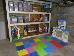 Kids Playroom in an Unfinished Basement white house black shutters
