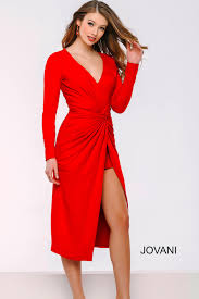 red in this long sleeve form fitting dress featuring ruching