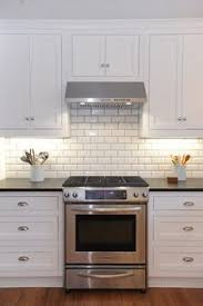 beveled subway tile with grey grout kitchen