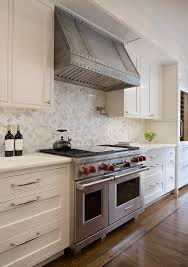 calcutta gold marble kitchen traditional with white countertop
