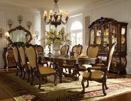 Formal Dining Room Centerpiece Design Idea With Two Candelabra And Large White Ceramic Flower Vase Also