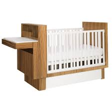 Zebra wood and white crib with storage and fold down changing