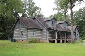 Log Cabin or Log Home Staining and Finishing Services
