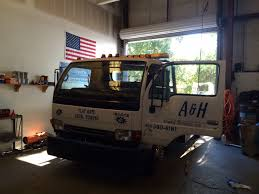 A&H Towing Picks Us For Auto Glass Replacement Pensacola, Fl ... Home Matchett Towing Recovery Pensacola Tow Truck Jerr Dan Trucks Nashville Tn Rembrance For Driver Killed In Train Crash Quality Preowned Dodge Dakota At Eddie Mcer Automotive Quality Car Stock Photos Uniforms Ud Bobs Auto Repair Types