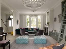 light teal living with ornate mirror frame living room