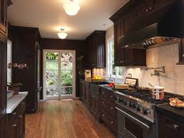 Dark Cabinets With Black Farmhouse Sink Kitchen Traditional And