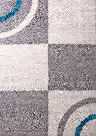 wohnzimmer teppich hochflor shaggy deko kariert streifen turkis creme grau pflegeleicht modern