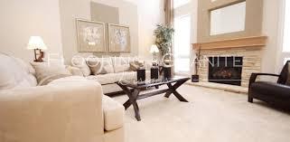 High Ceilings In Beautiful Loving Room Featuring Cream Carpet