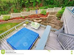 Two Level Backyard Deck With Jacuzzi On The First Floor And Patio ... Backyard Multi Level Paver Patio Steps Le Flickr Interlock Natural Stone Landscaping Minnesota Patios Southview Design 25 Beautiful Leveling Yard Ideas On Pinterest How To Level Creating A Meant Building Retaing Wall Behind Ideas Charcoal Slate Stones With Pea Stone Gravel Bethesda 365 Home Sales In Pool Ground And Setup 2014 Home Deck Foyer Garage Split Creative For Urban Outdoor Spaces Image Trending Sloped Backyard Sloping Modular Block Rhapes Also Back