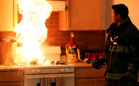 Firefighter Demonstrates The Incorrect Method Of Putting Out A Stovetop Fire With Water
