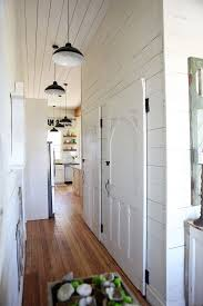 Joanna Gaines Age With Farmhouse Hall And Kitchen Pendant Lighting White Doors Paneling