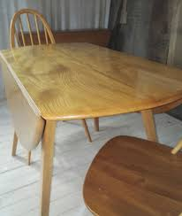 Ercol Extending Windsor Dining Table Refinished Solid Oak Farmhouse Table With 6 Chairs 2 Leaf Ding Fniture In A Range Of Styles Ireland Dfs Rugs 101 The Best Size For Your Room Rug Home 30 Decorating Ideas Pictures Of Inviting Blue Lamb Furnishings Round Vintage Dropleaf Table Total Kenosha Wi Lets Settle This Do Belong In Kitchen Amish Sets