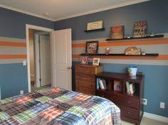 4 Year Old Sons Sport Theme Bedroom Blue Walls With Orange And Gray Stripes